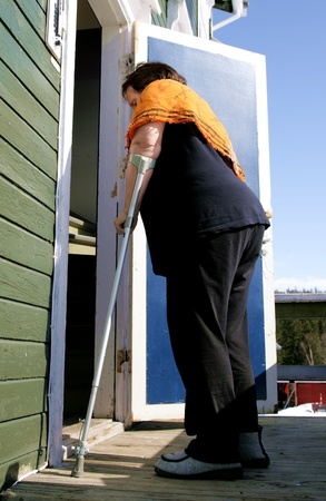 Disabled woman with crutch Stock Photo - 13171338