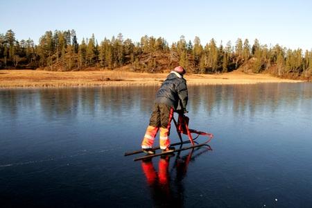 frozen lake: Man riding a cick sled on a frozen lake