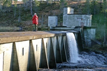 industry architecture: Man fishing on an old dam Stock Photo