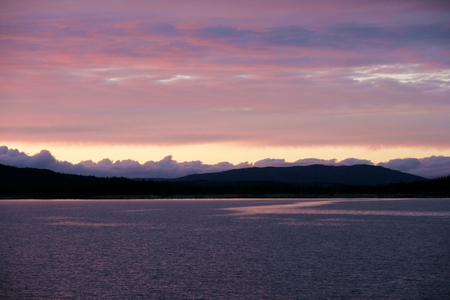 pink skies: Clouds over a lake in the evening