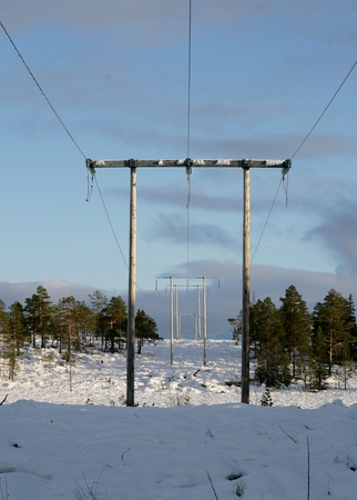 High voltage  in a winter landscape