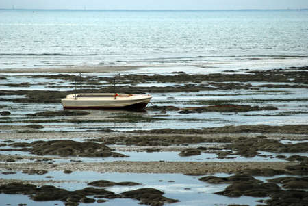 low tide: boat and low tide