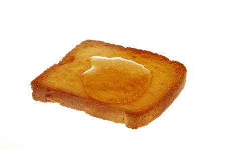 rusk and honey with white background                      photo