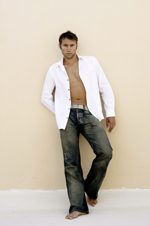 Tanned Male with White open Shirt Standard-Bild