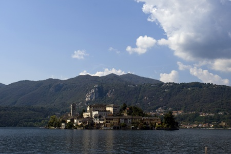 Picturesque views of the Lake Orta Island in summer with cloudy sky