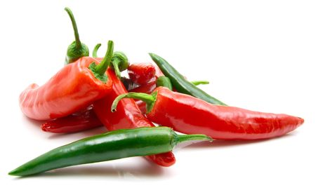 pungent: red and green peppers isolted on the white background