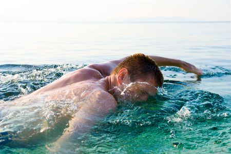 swimming man and clean ocean water Stock Photo - 3422207