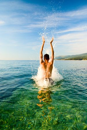 man is jumping from clean water Stock Photo - 3422173