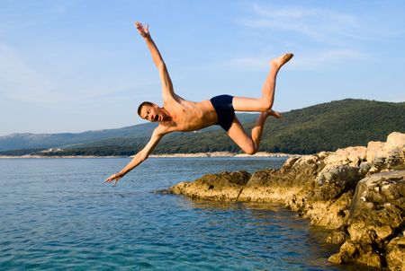 man jumping from rock in sea water and screaming aaaa Stock Photo - 3458019