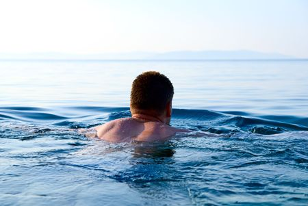 morning light and swimming man in ocean Stock Photo - 3518348