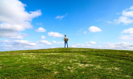one traveler stand on top of mountain in north tundra Stock Photo - 3543961