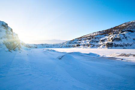 sunset in winter mountain tundra photo