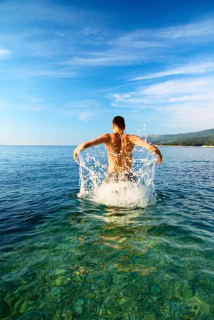 man are jumping from clean water Stock Photo - 3679187