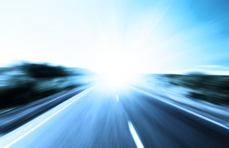 motion blur road and sun photo