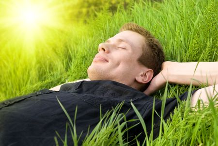 young man relax under summer sun photo