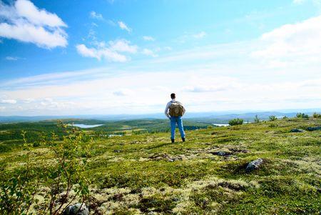 mountin: one traveler walking in north mountin tundra