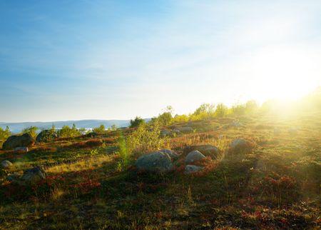 sunset in mountain autumn tundra photo