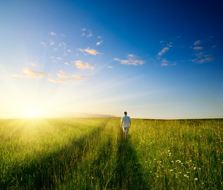 one man and field of summer grass and sunset  Stock Photo - 3960006