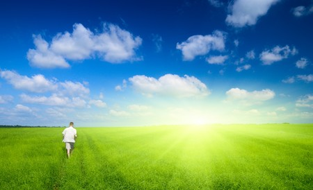 one man and field of green grass Stock Photo