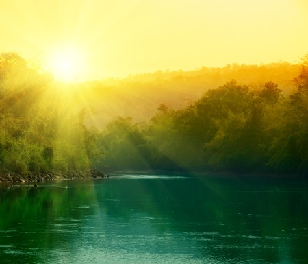 sunset in jungle of Thailand photo