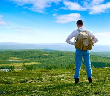 one traveler walking in north mountin tundra Stock Photo - 4586208