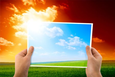 photo of green field in hands photo