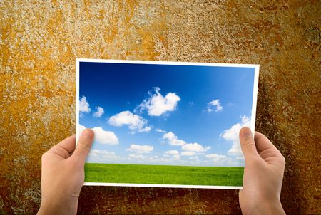 paper in hands and wall Stock Photo - 4736302