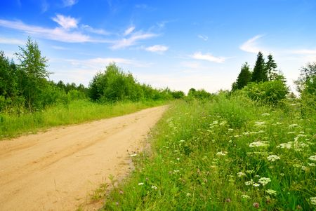 road from sand and perfect summer day photo