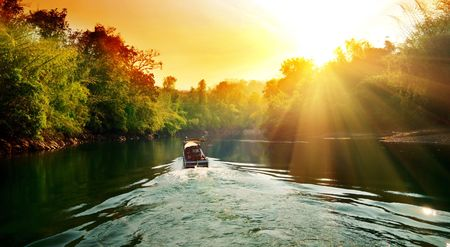 sunset in jungle and boat photo