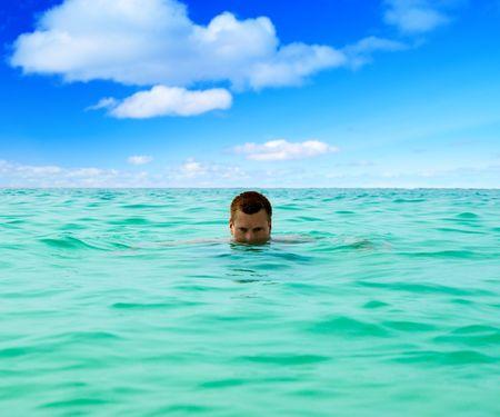 swiming man in tropical sea Stock Photo - 4827203