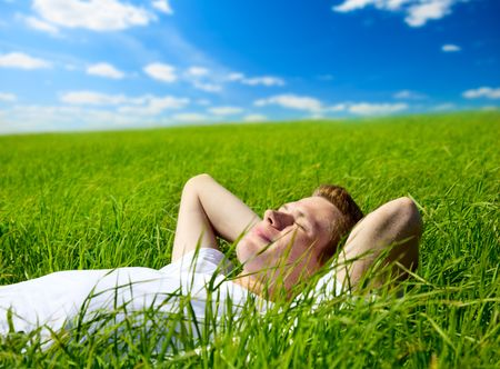 young man in spring grass Stock Photo - 5055558