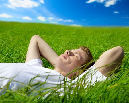 young adult man in spring grass Stock Photo - 5055562