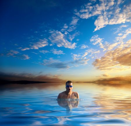 sunset and swiming young man Stock Photo - 5088048