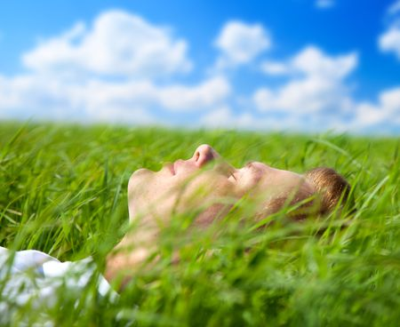 young man in spring grass Stock Photo - 5088045
