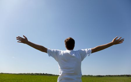 happy young man and spring field Stock Photo - 5130026