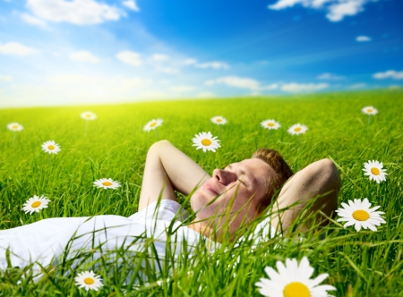 young man in flowers Reklamní fotografie - 5130027