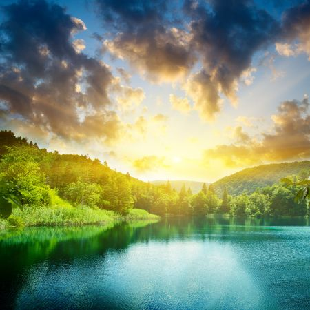 rivers mountains: green water lake and sunset Stock Photo