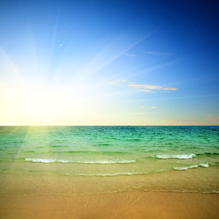 sunrise at the beach: sunset and ocean Stock Photo