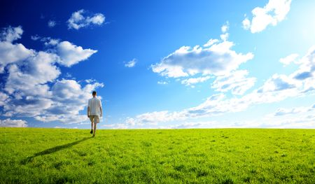one man and field of spring grass and sunset Stock Photo - 5252691