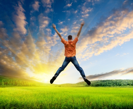 victory: happy jamping young man Stock Photo