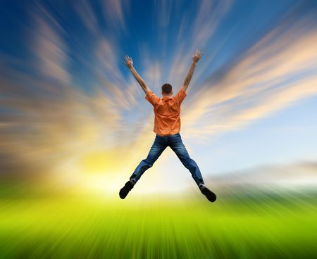happy jamping young man and motion blur field Stock Photo - 5351914