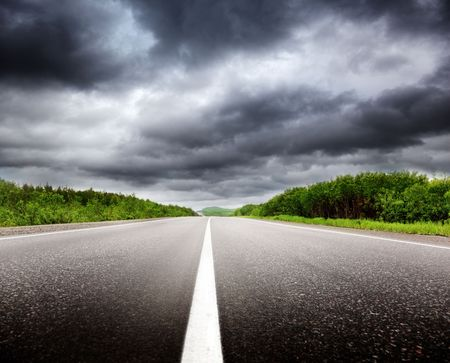 sulight: black clouds and road