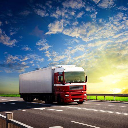 speeding: truck on highway and sunset