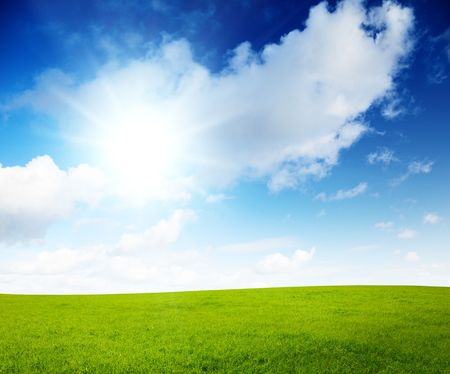 sunny spring day and green field Stock Photo - 5771314
