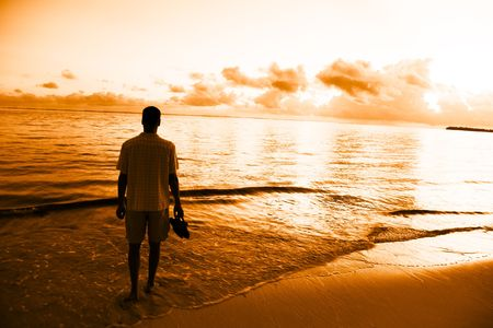 young man and sunset on Caribbean sea Stock Photo - 6059817