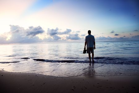 boy alone: young man and sunset on sea Stock Photo