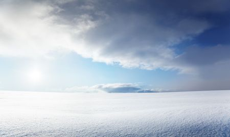 field of snow and cloudy sky photo
