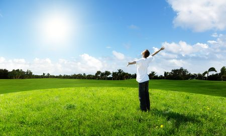 young man relax on the green field Stock Photo - 6628303