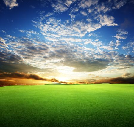 field of grass and perfect sunset sky Stock Photo