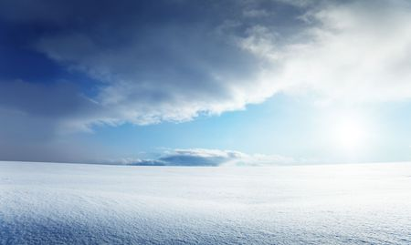 field of snow and cloudy sky Stock Photo - 6689157